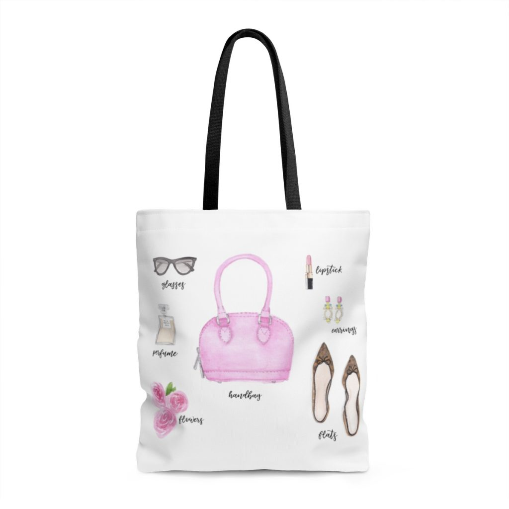black and white tote with watercolour art; sunglasses, pink lipstick, pink handbag, perfume bottle, pink roses, earrings, flat pointy tortoise shoes