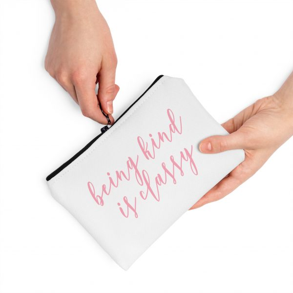being-kind-cosmetic-bag-shown-with-hands