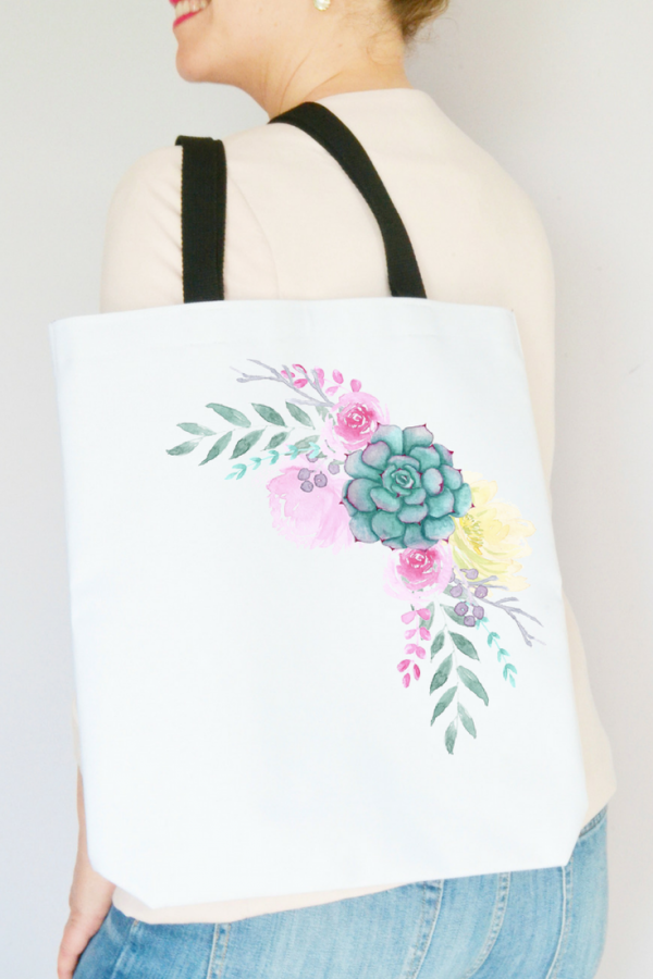 woman-holding-floral-succulent-tote-bag