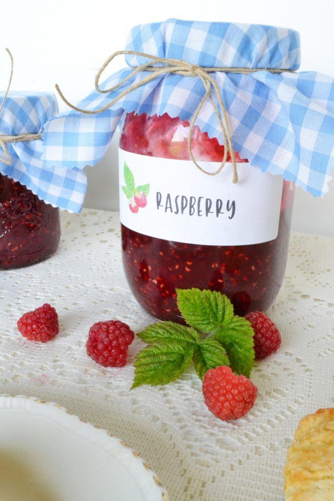 raspberry-jam-jar-single-raspberries-white-tablecloth