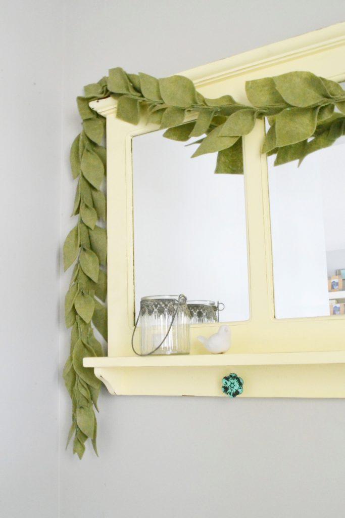 leaf-garland-on-yellow-mirror