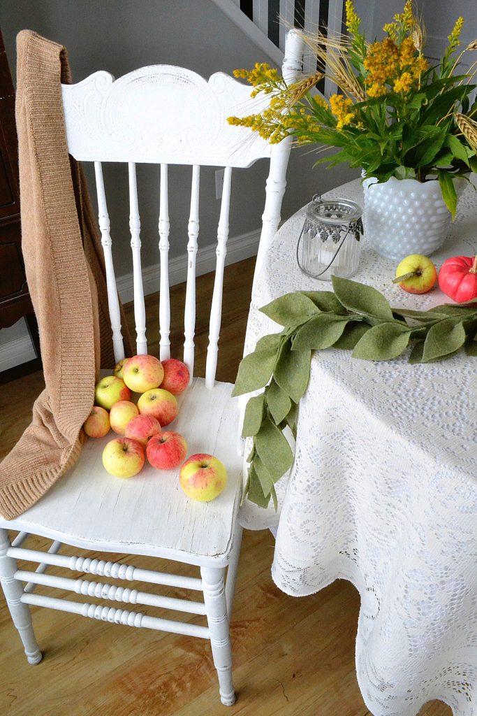 felt-leaf-garland-white-chair-apples